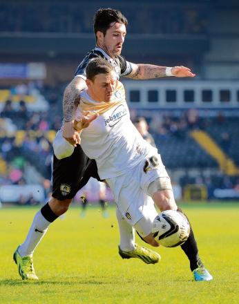 Tussle - U's skipper Brian Wilson battles for the ball during his side's 2-0 defeat at Notts County, last weekend. Picture: WARREN PAGE