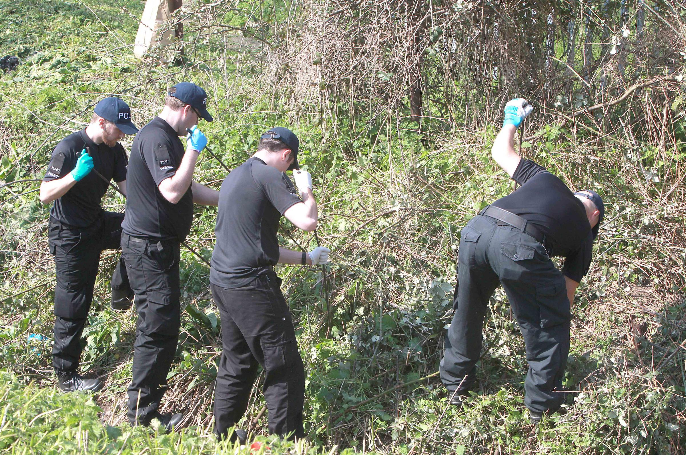 Officers searching the area yesterday