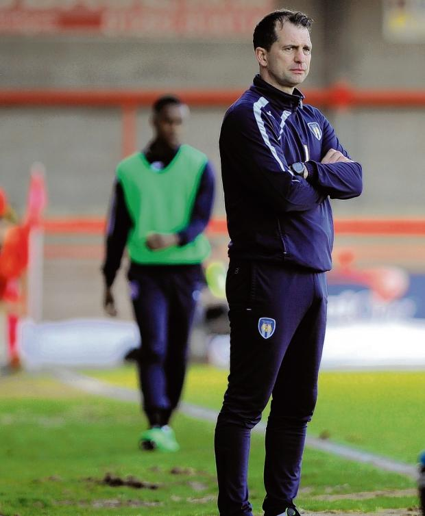 Essex County Standard: Up for the battle - Colchester United boss Joe Dunne knows how important his side's crunch game against Tranmere Rovers is tomorrow. Picture: WARREN PAGE