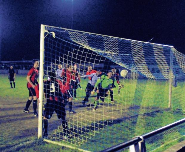Essex County Standard: Paul King scores the vital second goal for Witham against Chatham. Picture: JIM PURTILL