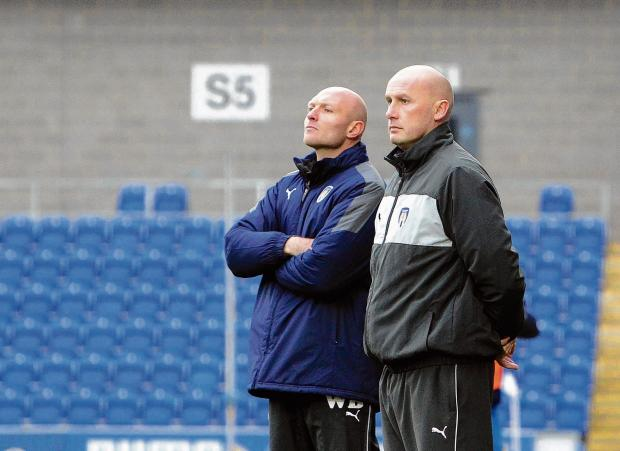 Essex County Standard: Up for the cup - Wayne Brown (left) and John McGreal will be hoping to lead Colchester United under-18s to victory in their Youth Alliance Cup Final tonight. Picture: STEVE ARGENT (CO72711-22)
