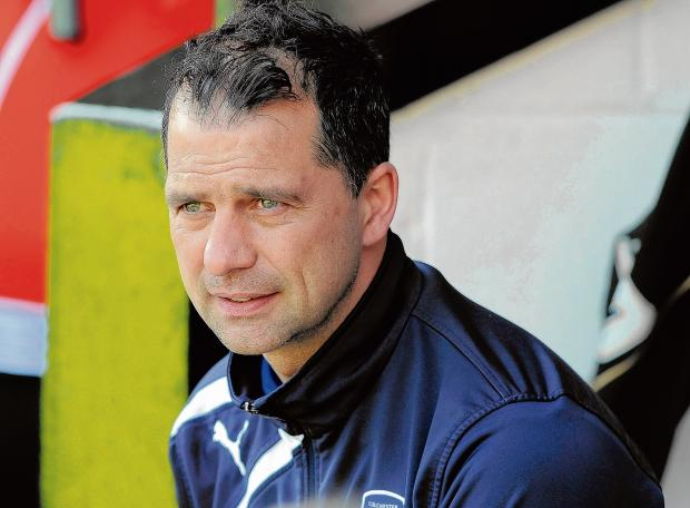 Essex County Standard: Mission accomplished - U's boss Joe Dunne believes his side have made progress in the 2013-14 season. Picture: WARREN PAGE
