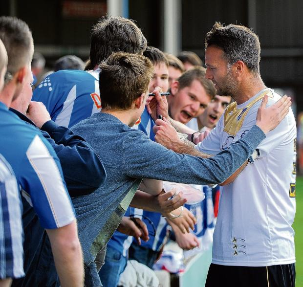 One last time - Karl Duguid says goodbye to Colchester United fans following his last-ever playing appearance for the club at Walsall. Picture: WARREN PAGE