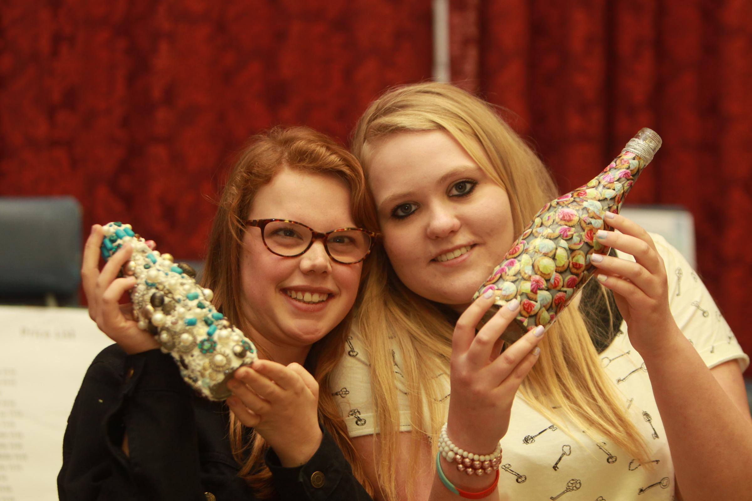 Courtney Smith and Jo Edridge with recycled bottles.