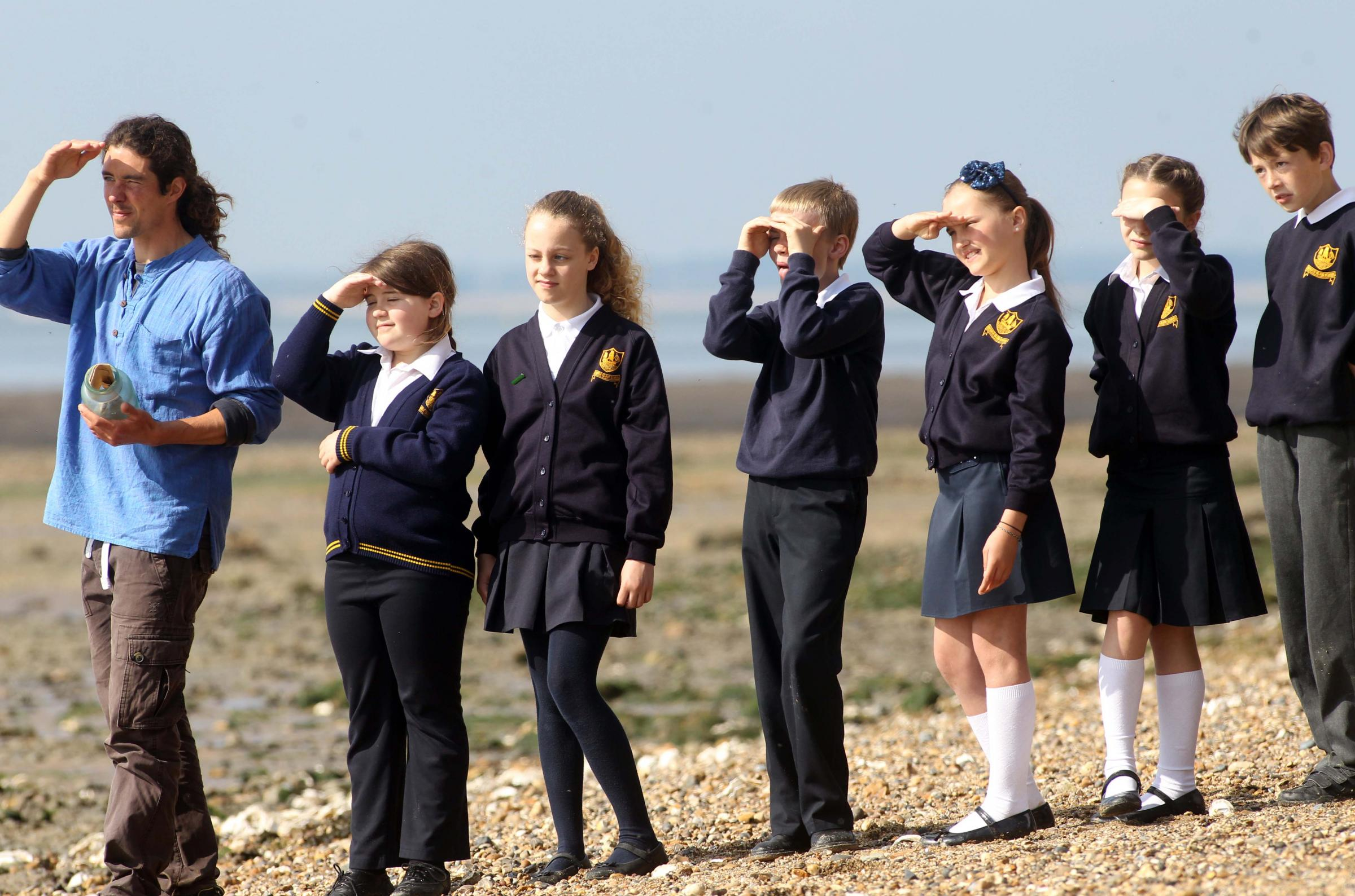 Here it comes – Charlotte Lake, Ben Rumble, Alannah Murrell, Amber Jones, Cameron Hope and Zoe Clegg watch the flypast