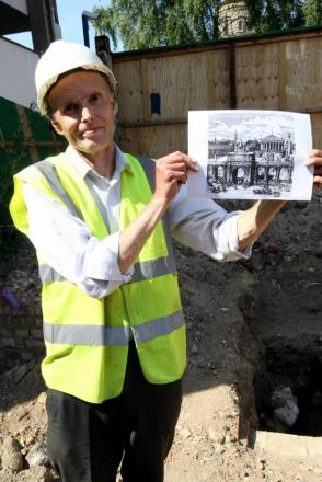 ARchaelogist Don Shimmin near the Roman remains with an image of how the arcade would have looked