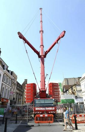 Shoppers stop and stare as Will Gee's huge crane shuts High Street