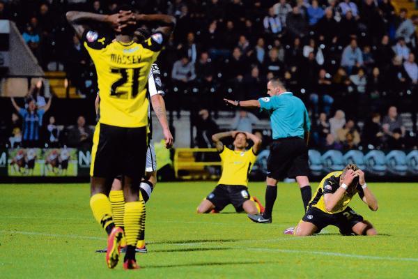 Agony - Colchester United's players can't believe it after another chance goes begging at Meadow Lane. Picture: RICHARD BLAXALL