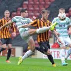 Essex County Standard: Yeovil's Joe Edwards gets to the ball ahead of Billy Clarke