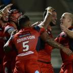 Essex County Standard: Weller Hauraki, second right, celebrates after scoring Salford's second try